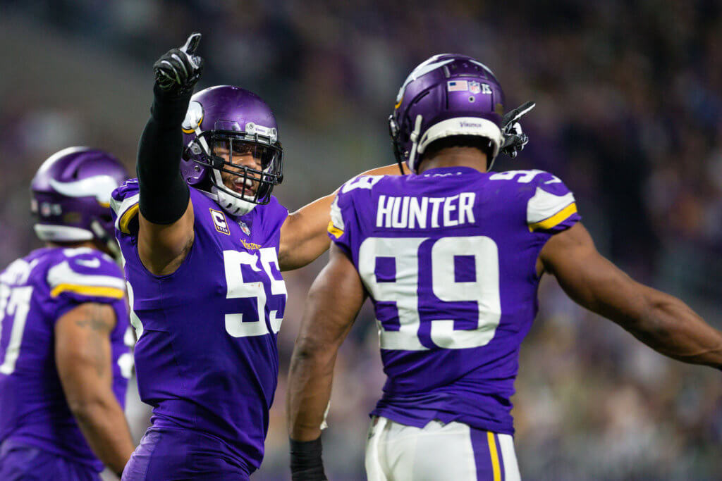 Danielle Hunter celebrates with Anthony Barr after a play.