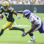Davante Adams catches a pass against Xavier Rhodes.