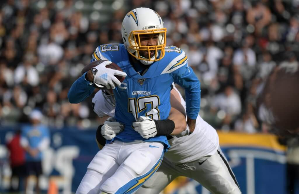 Keenan Allen makes a move to pick up additional yards.