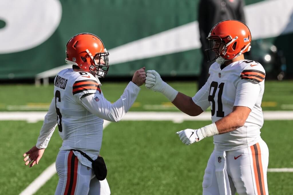 Austin Hooper and Baker Mayfield with a fist bump.